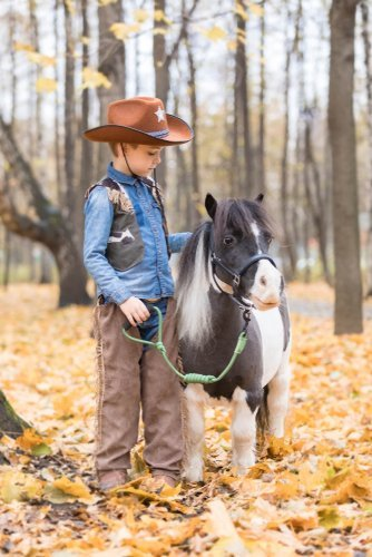 A boy with a small pony. | Source: Shutterstock.