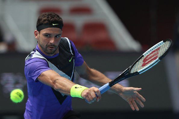 Grigor Dimitrov of Bulgaria returns a shot in the Men's singles first round match against Andrey Rublev of Russia of 2019 China Open at the China National Tennis Center on September 30, 2019, in Beijing, China. | Source: Getty Images.