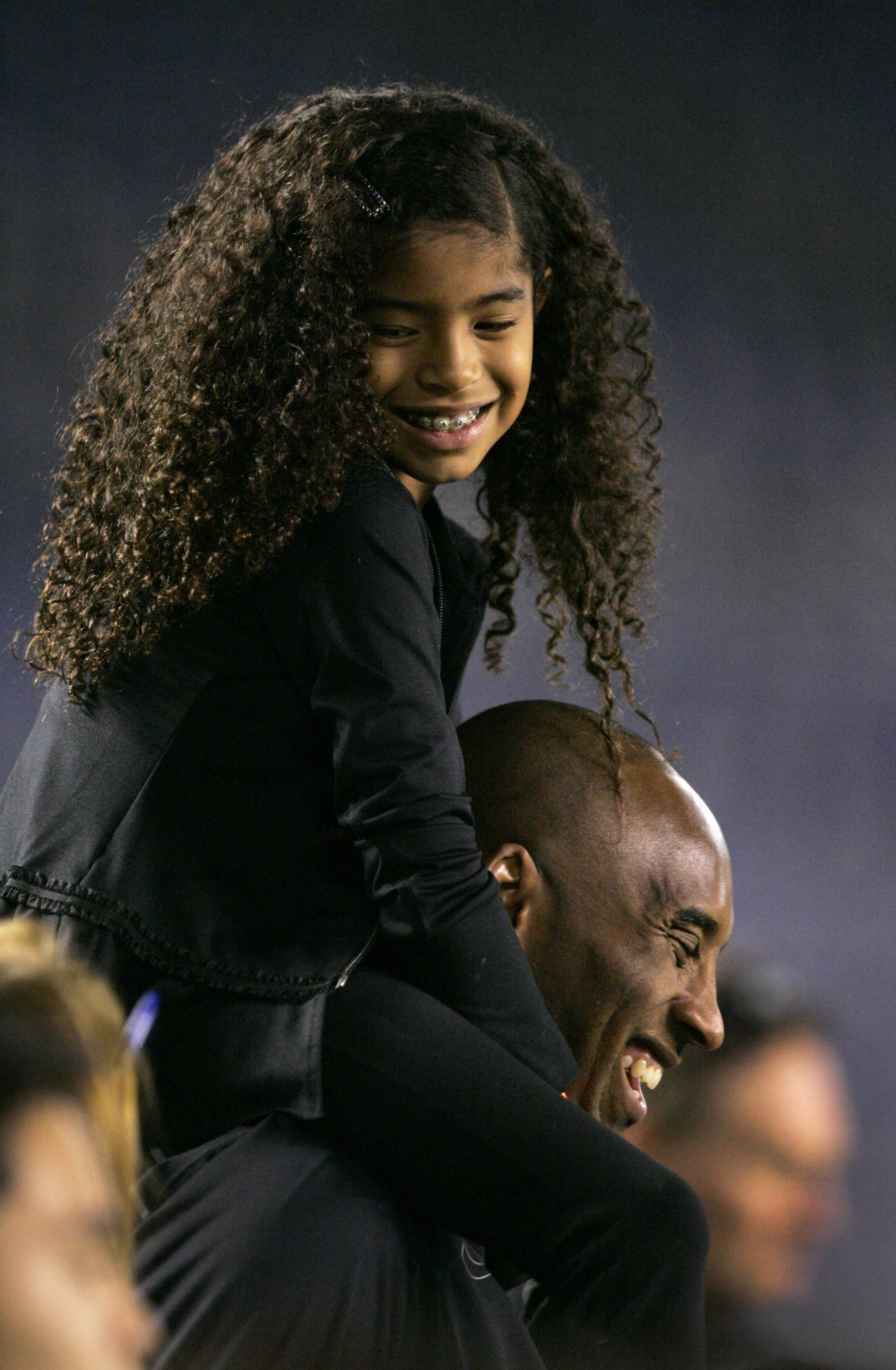 Kobe Bryant with his daughter Gianna Maria-Onore Bryant at the game against the United States and China during an international firendly match  on April 10, 2014, in San Diego, California. | Source: Getty Images.