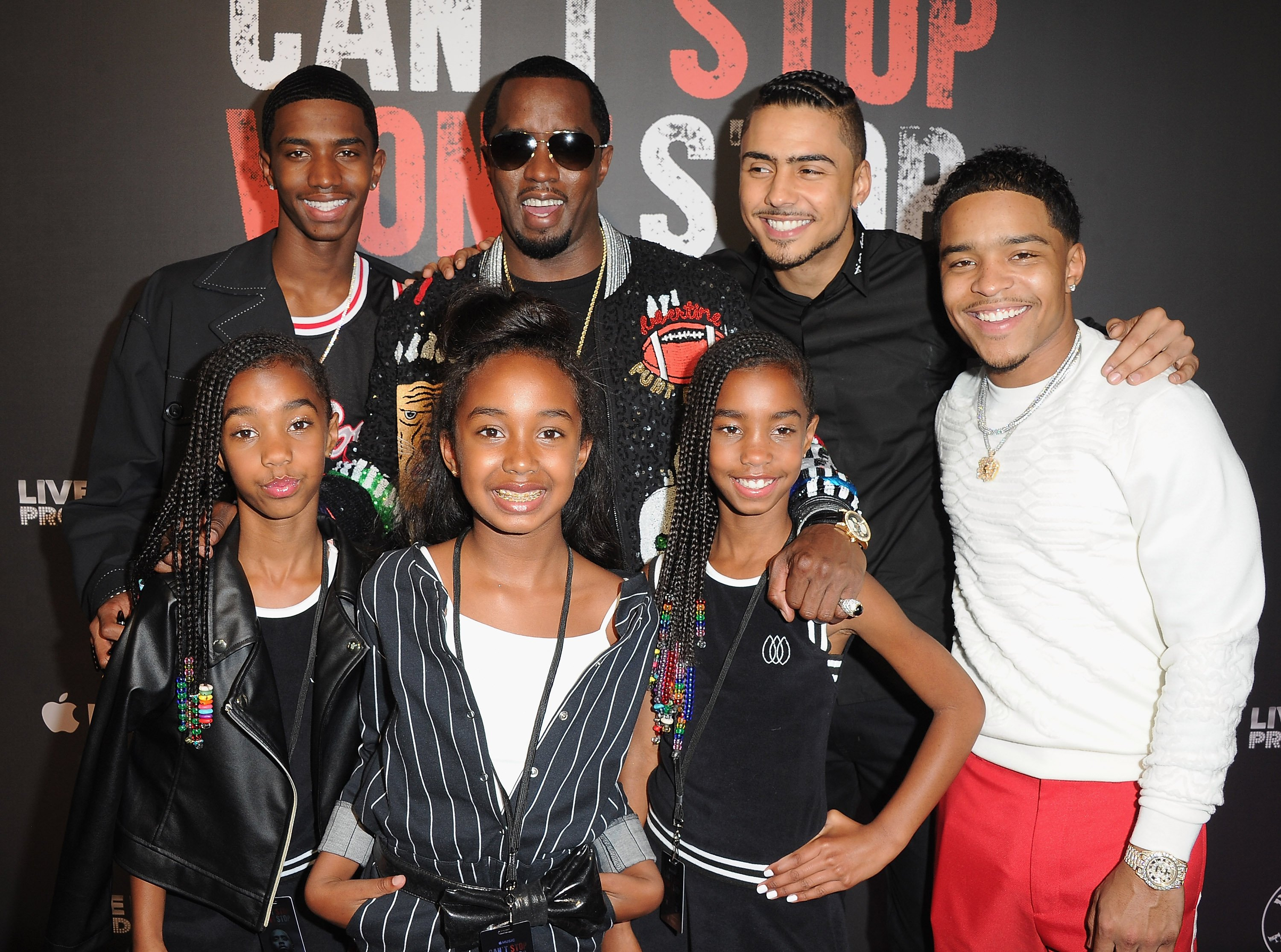 "Sean Combs and his children arrive at the Los Angeles Premiere Of ""Can't Stop Won't Stop"" at Writers Guild of America, West in Los Angeles, California on June 21, 2017 