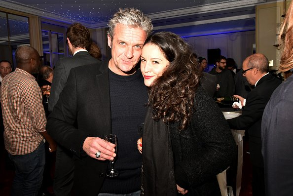 David Brecourt et Alexandra Sarramona à l'Automobile Club France le 16 décembre 2015 à Paris, France. | Photo : Getty Images