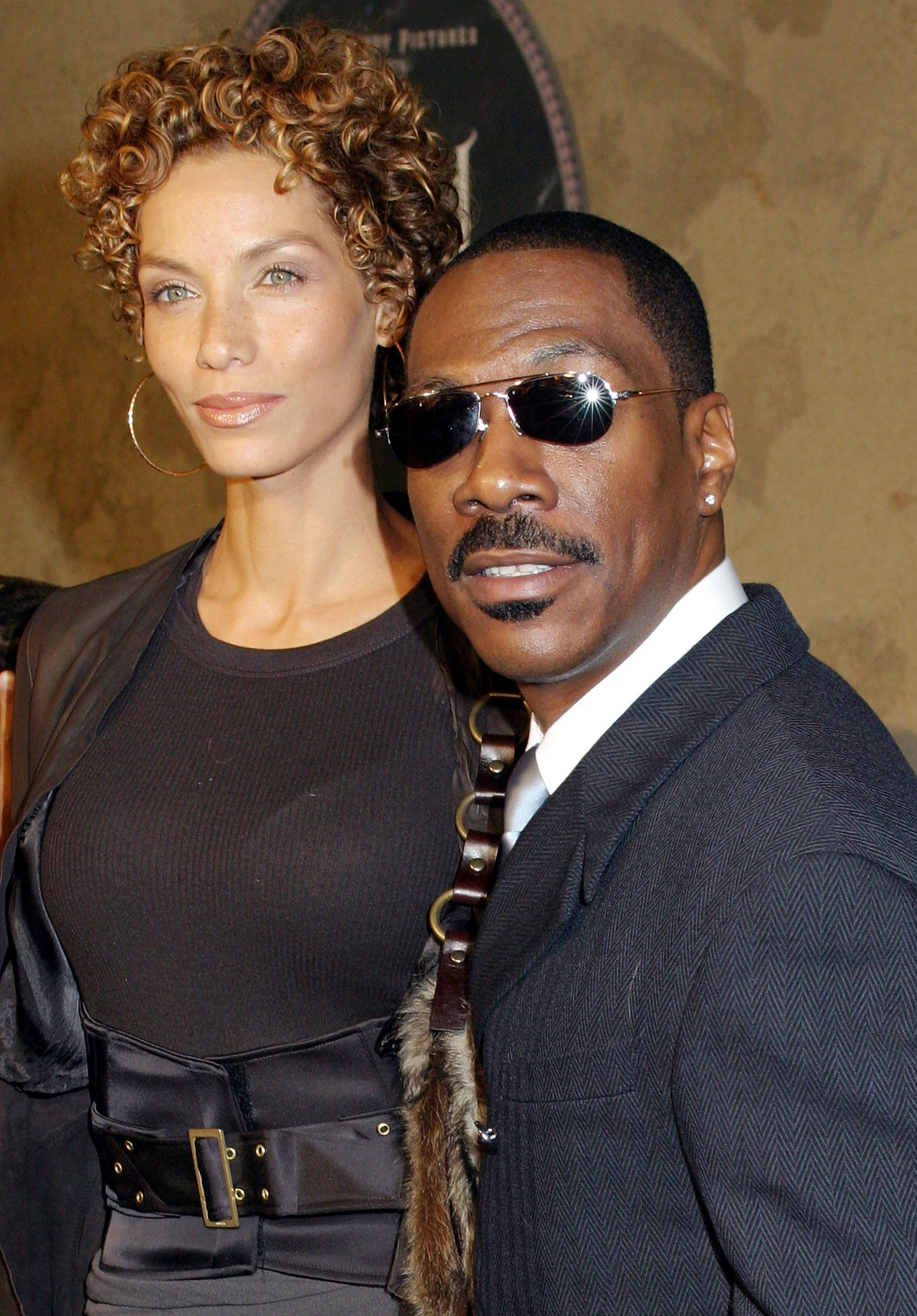 """Eddie Murphy and Nicole Murphy at the world film premiere of """"The Haunted Mansion"""" at the El Capitan Theatre on November 23, 2003 in Hollywood, California 