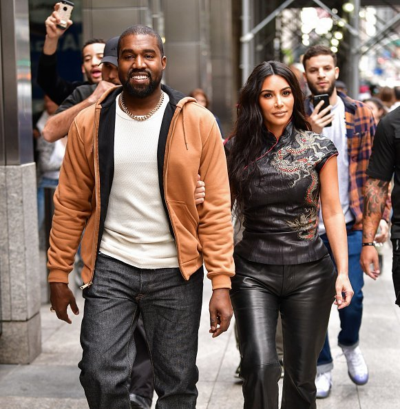 Kanye West and Kim Kardashian West walk along 57th Street on October 25, 2019 | Photo: Getty Images