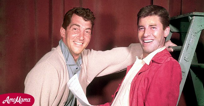 Dean Martin (1917-1995), US actor and singer, with Jerry Lewis, US actor and comedian, smiling in a studio portrait, with Lewis holding a script while leaning against a step ladder, USA, circa 1952.   Source: Getty Images
