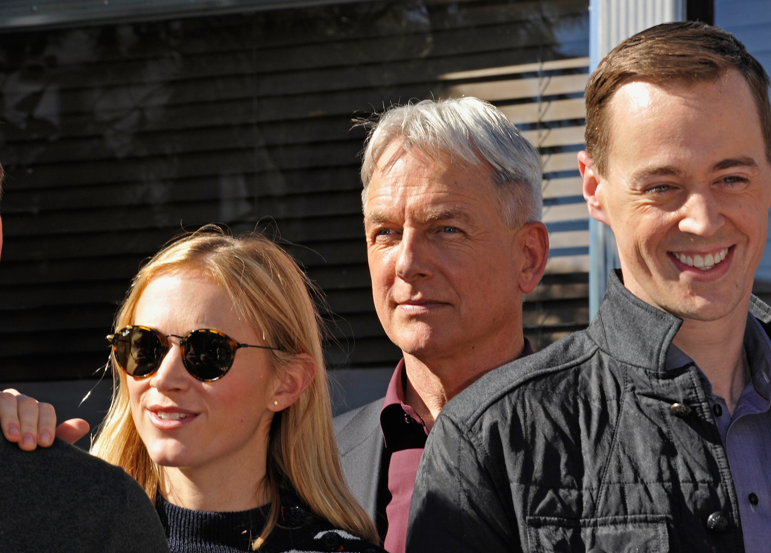 "Actors Emily Wickersham, Mark Harmon, and Sean Murray attend the cake cutting celebration for ""NCIS"" 300th episode. 
