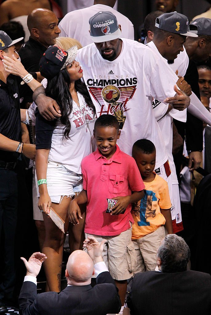 LeBron James #6 of the Miami Heat celebrates his wife Savannah Brinson and family after they Heat won 121-106 against the Oklahoma City Thunder in Game Five of the 2012 NBA Finals, Jun 21 2012 | Photo: Getty Images