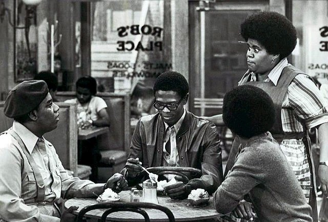 """Shirley Hemphill looking at  Fred Berry, Ernest Lee Thomas, and Haywood Nelson while shooting """"What's Happening!!"""" circa 1977 