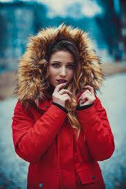 Woman wearing a jacket with fur.   Photo: Pexels
