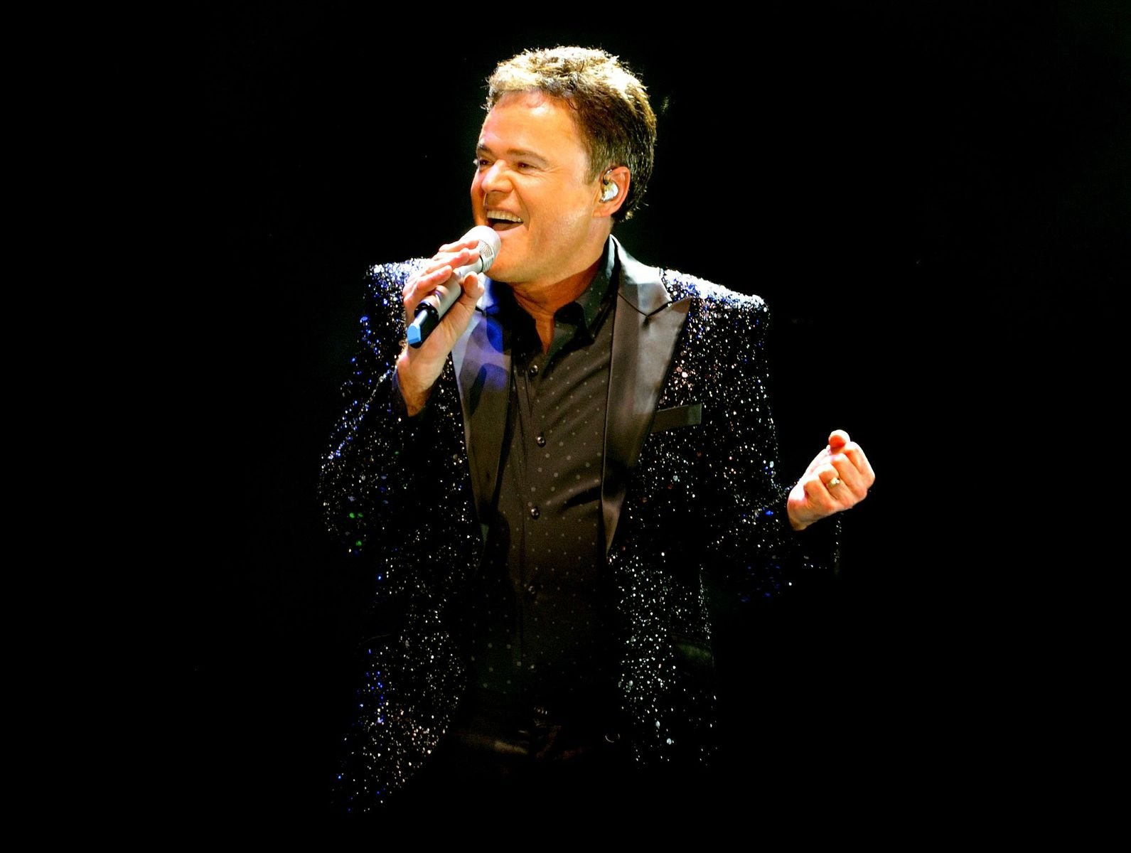 Donny Osmond on stage at Manchester Arena on January 21, 2017 | Photo: Getty Images