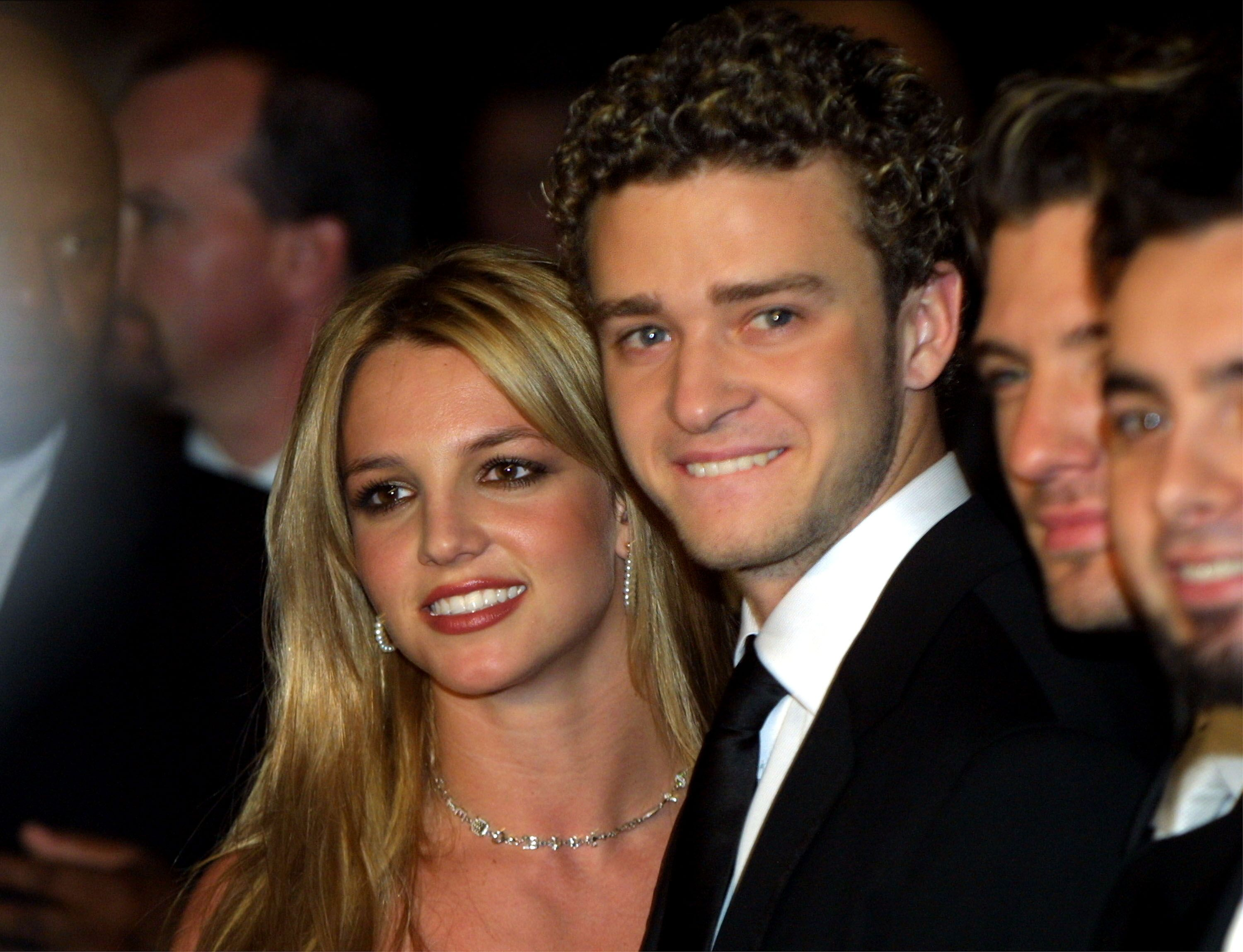 Britney Spears and boyfriend Justin Timberlake from the band N'sync at Clive Davis'' pre-grammy awards gala in 2002 in Beverly Hills | Source: Getty Images