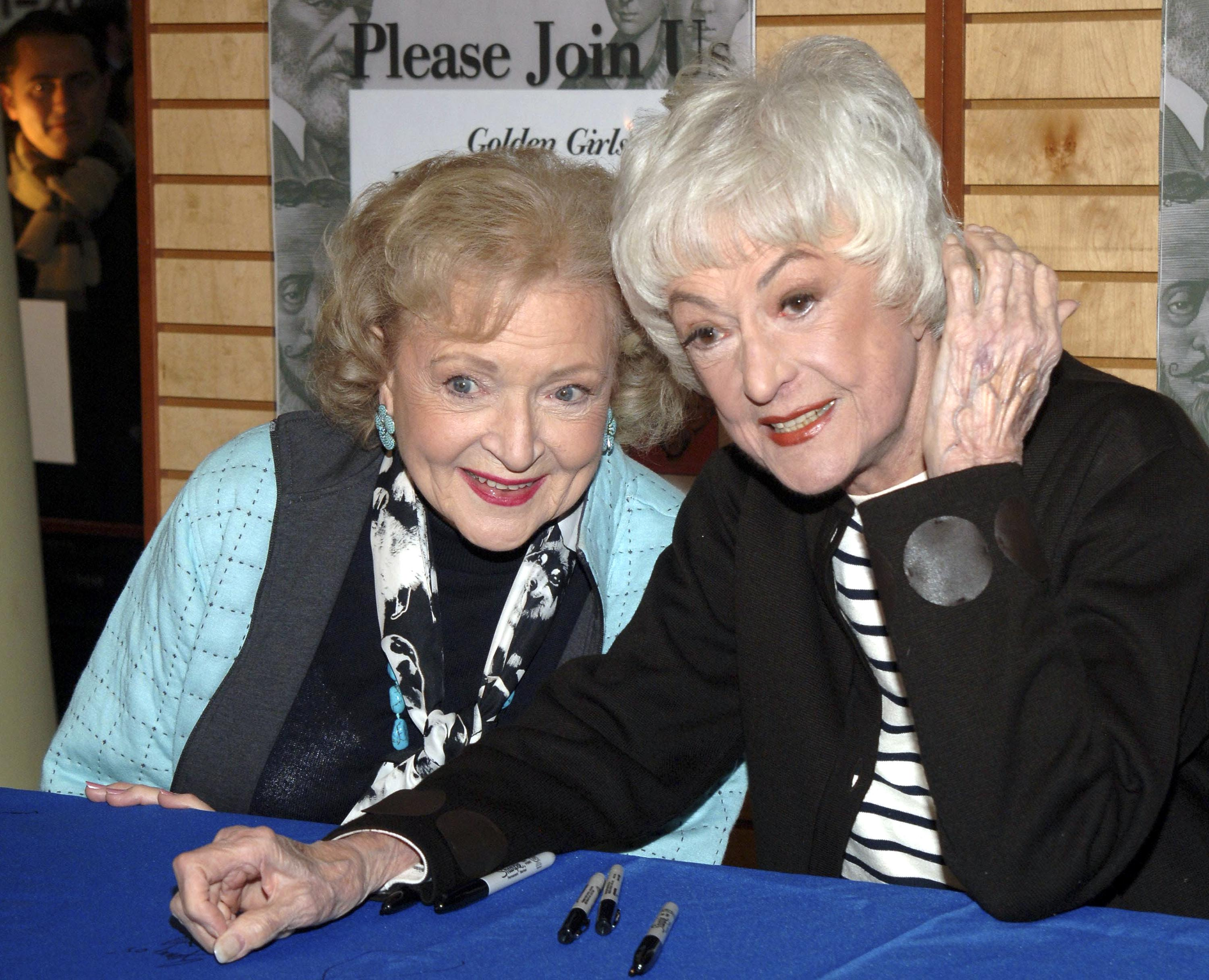"""Betty White and Bea Arthur sign copies of """"The Golden Girls Season 3"""" in New York City on November 22, 2005 