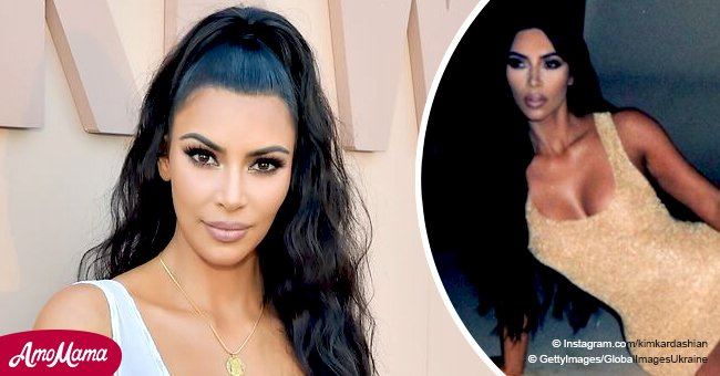 Kim Kardashian dons a tiny dazzling gold dress, putting her slender legs on full display