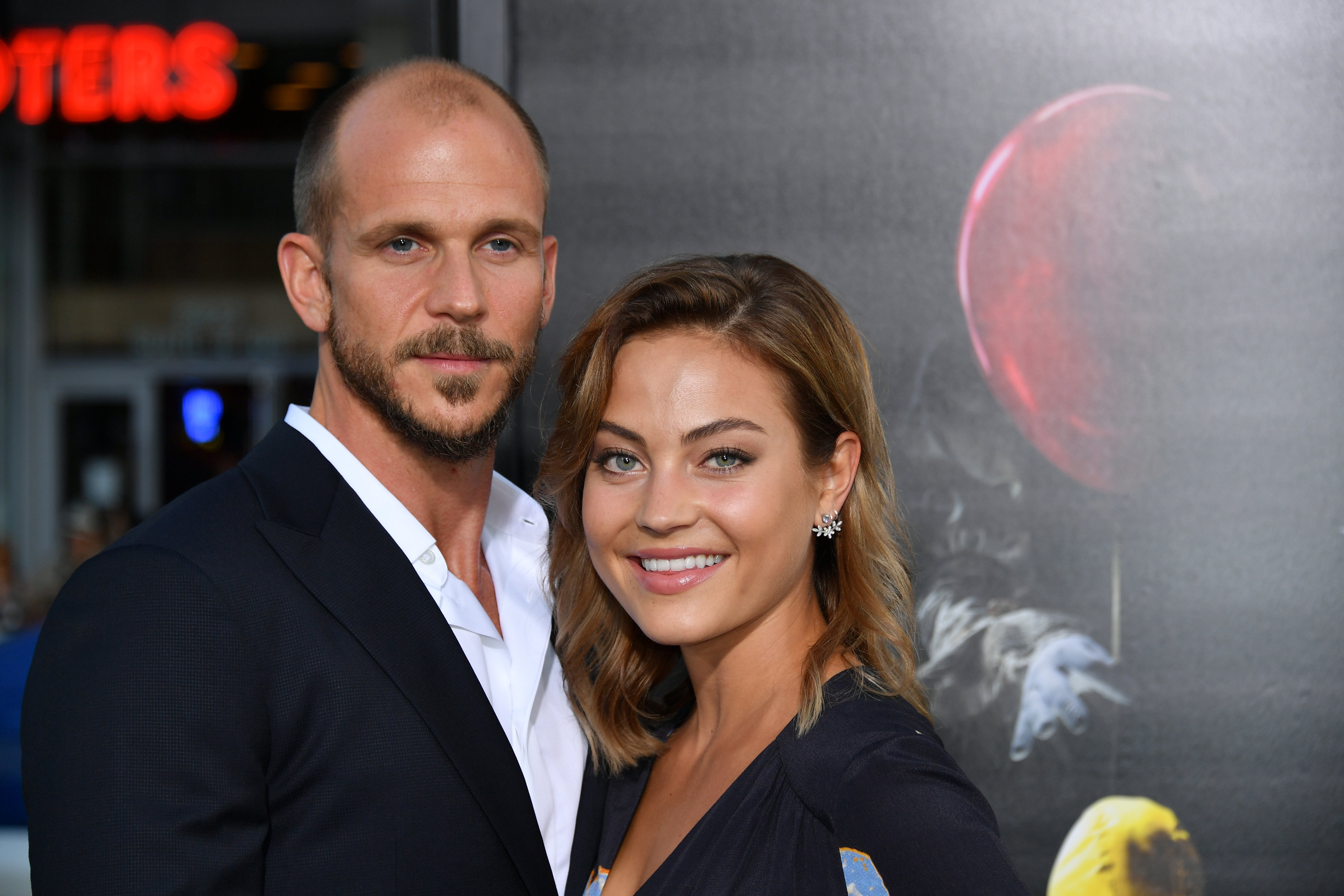 """Gustaf Skarsgard and Caroline Sjostrand attend the premiere of Warner Bros. Pictures and New Line Cinema's """"It"""" at the TCL Chinese Theatre on September 5, 2017 in Hollywood, California 
