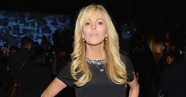 Dina Lohan at the Nicole Miller fashion show during Mercedes-Benz Fashion Week Fall 2014 at The Salon at Lincoln Center in New York City | Photo: Larry Busacca/Getty Images for Mercedes-Benz Fashion Week