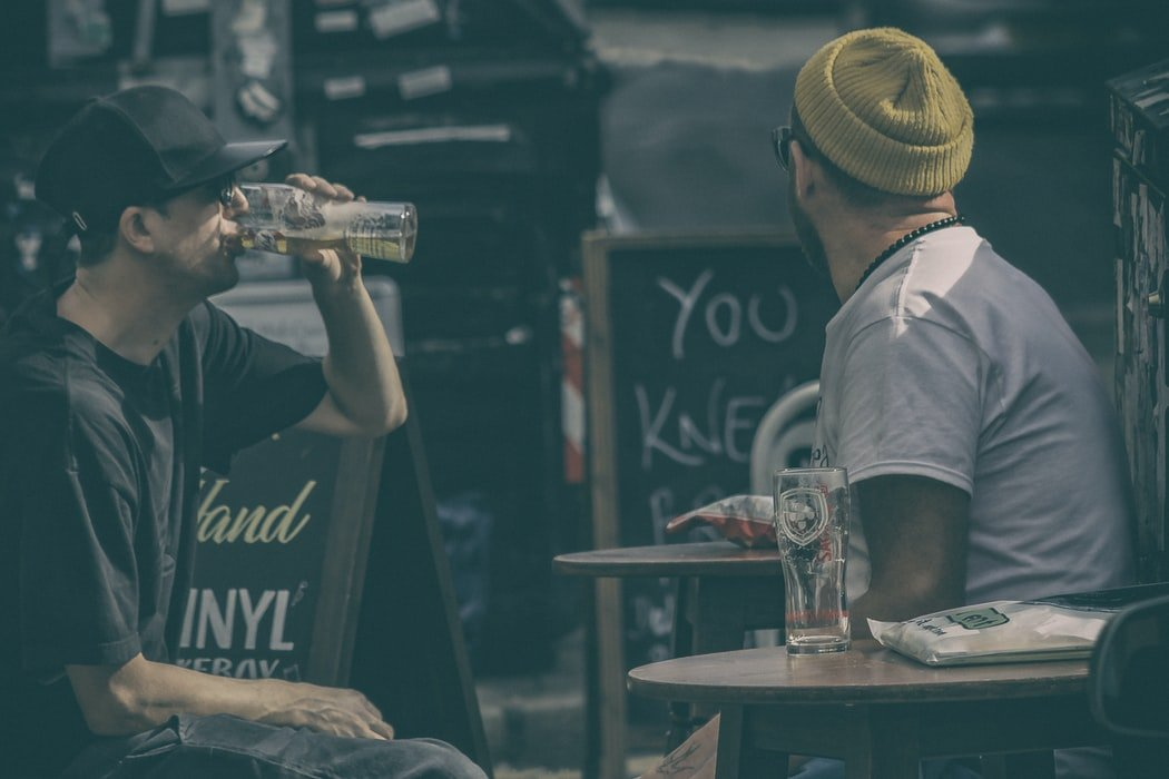 Drinking beers at the bar   Source: Unsplash