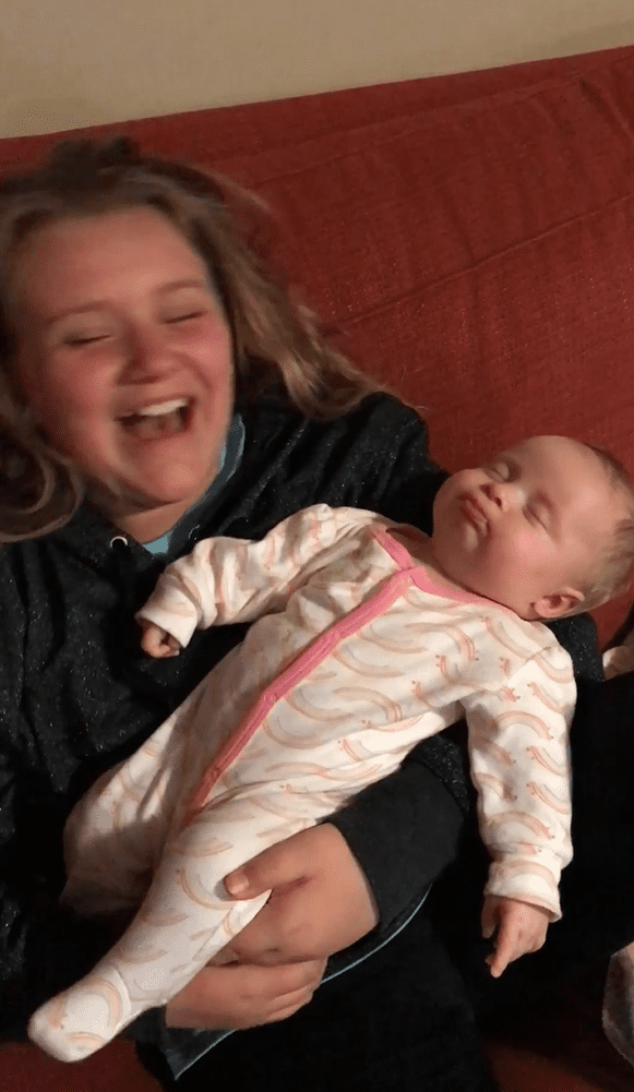 9-year-old Allie laughing while holding her 7-week-old sister Ashlyn. | Source: facebook.com/foreverymom