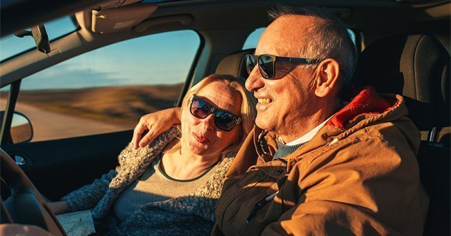 A senior couple traveling in a car | Photo: Shutterstock.com
