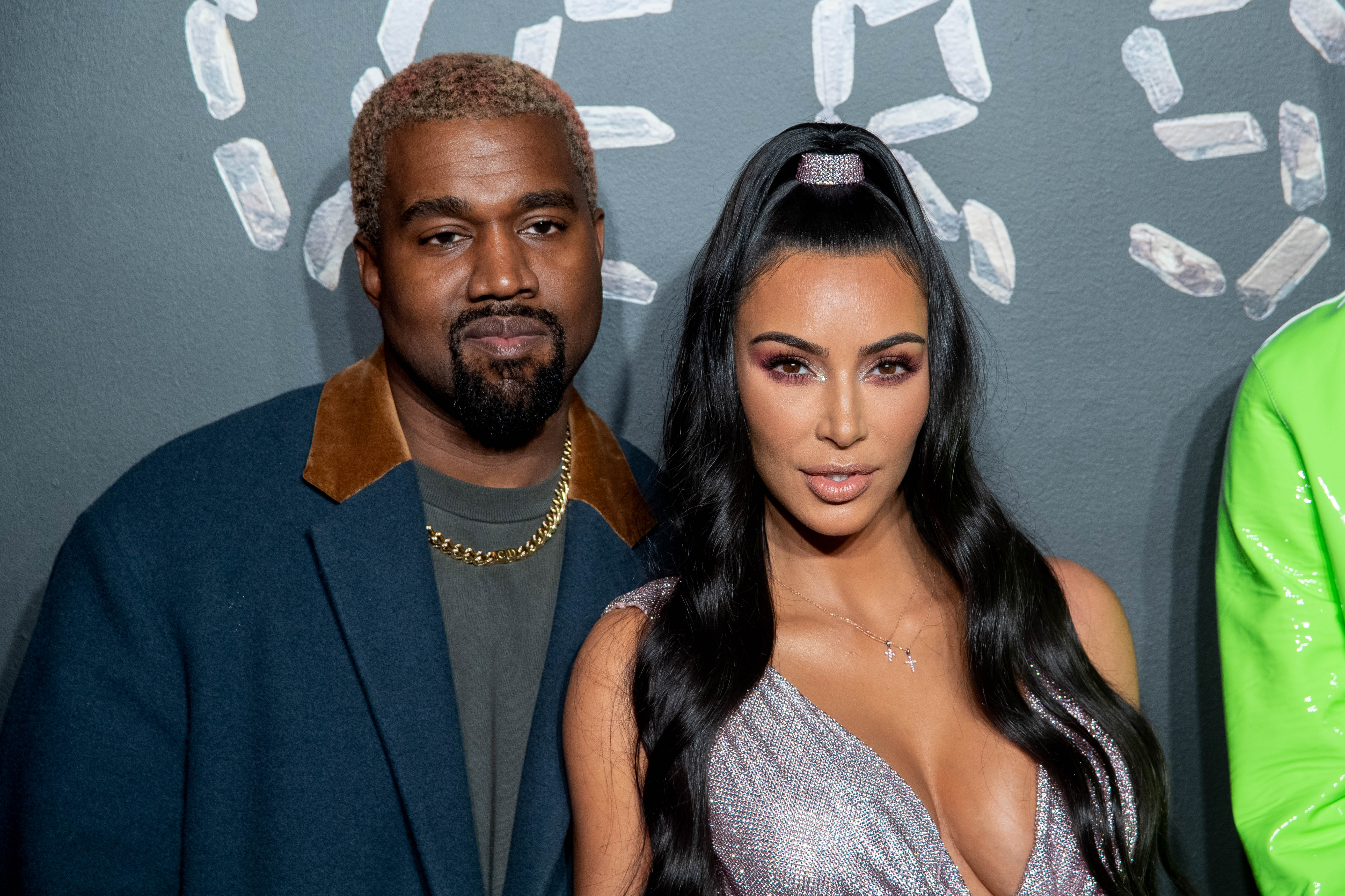 Kanye West and Kim Kardashian West at the the Versace fall 2019 fashion show held at the American Stock Exchange Building in lower Manhattan on December 02, 2018 in New York City | Photo: Getty Images