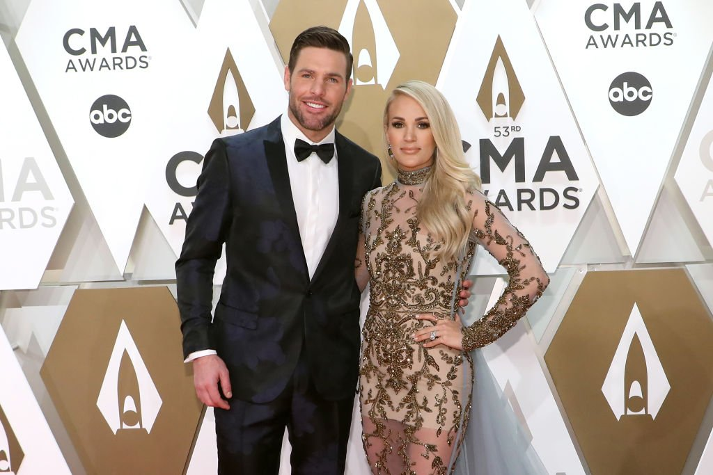 Mike Fisher and Carrie Underwood attend the 53nd annual CMA Awards at Bridgestone Arena. | Photo: Getty Images