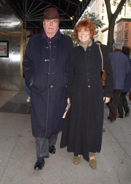 Robert Wagner walking along Madison Avenue with Jill St. John on November 6, 2004, in New York City. | Source: Getty Images.