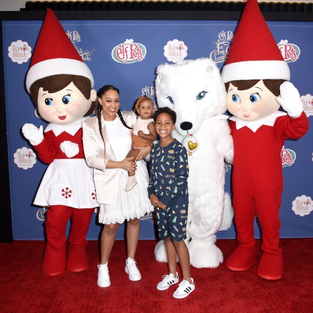 "Tia Mowry with her two children, Cree and Cairo Hardrict attending the advanced screening of ""Elf Pets: A Fox Club's Christmas Tale"" in June 2019. 