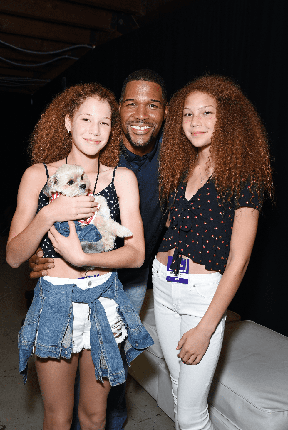 Michael Strahan and his twin daughters, Sophia and Isabella, pose during  at the Nickelodeon Kids' Choice Sports 2018 on July 19, 2018 in Santa Monica, California. | Source: Getty Images