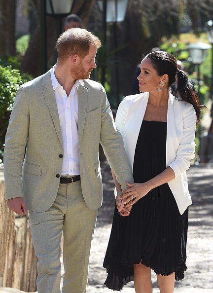 Prince Harry, Duke of Sussex and Meghan, Duchess of Sussex walk through the walled public Andalusian Gardens which has exotic plants, flowers and fruit trees during a visit on February 25, 2019, in Rabat, Morocco. | Source: Getty Images.