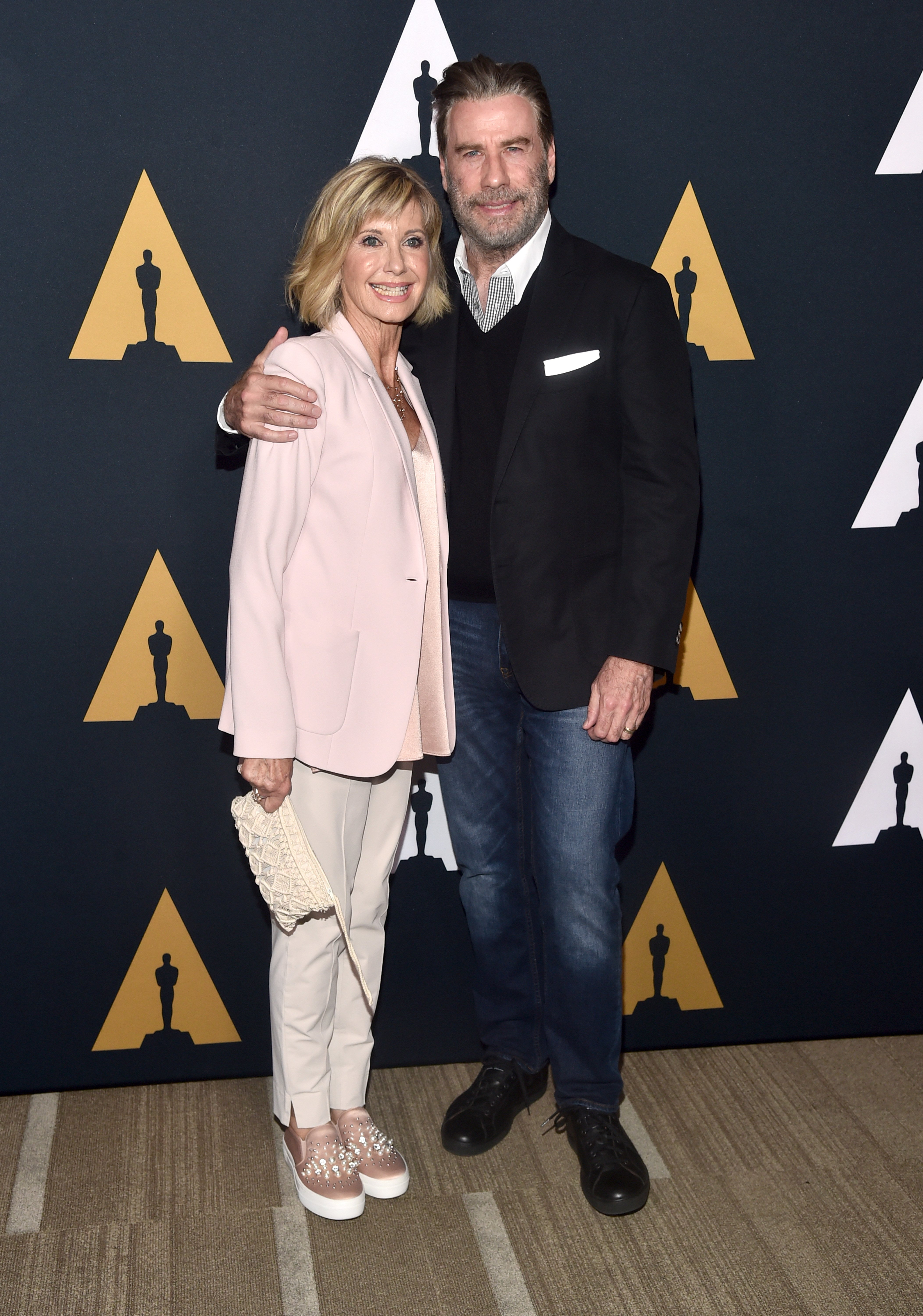 "Olivia Newton-John and John Travolta attend the ""Grease"" 40th anniversary screening on August 15, 2018, in Beverly Hills, California. 