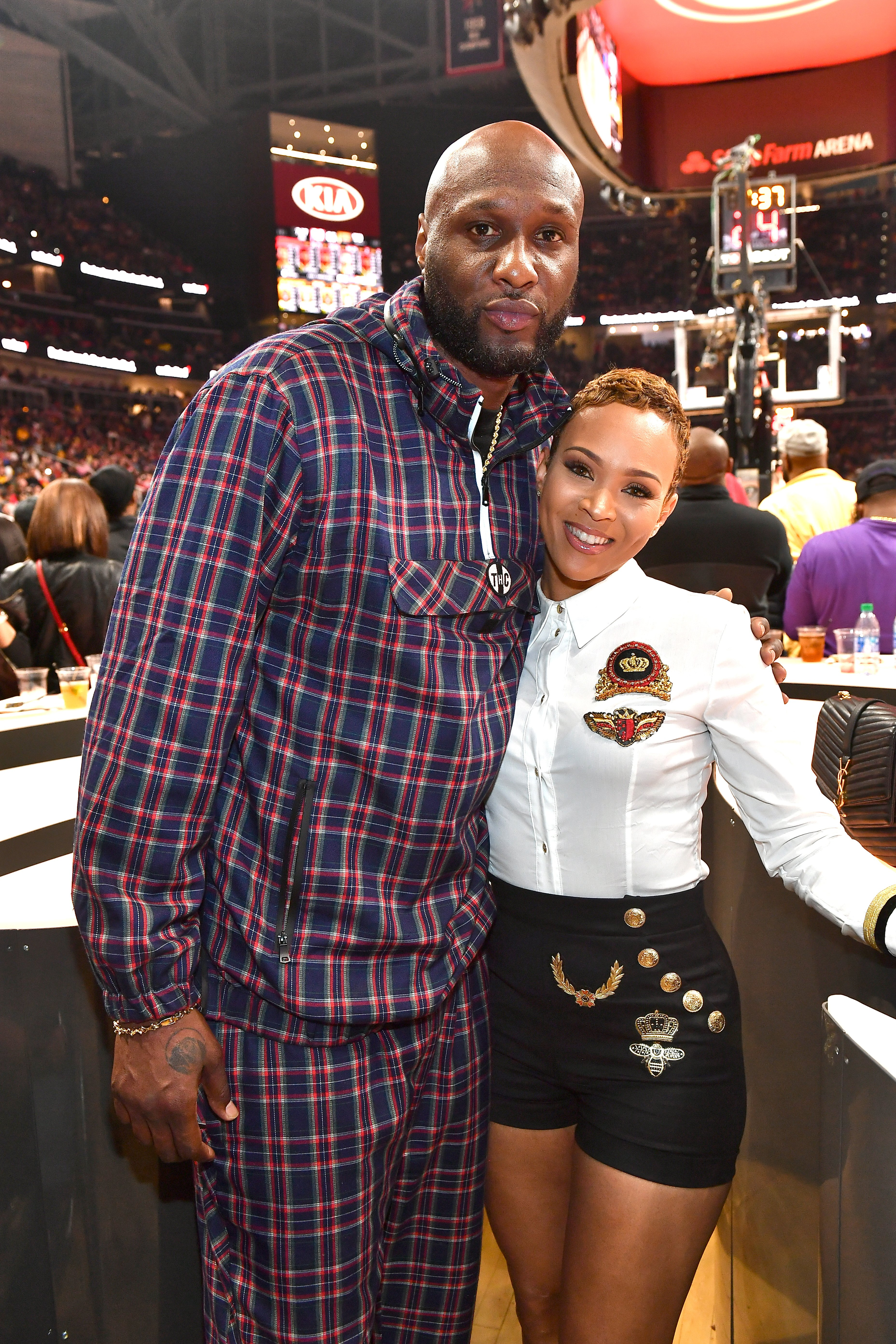 Lamar Odom and Sabrina Parr attend Los Angeles Lakers vs Atlanta Hawks at State Farm Arena,2019| Photo: Getty Images