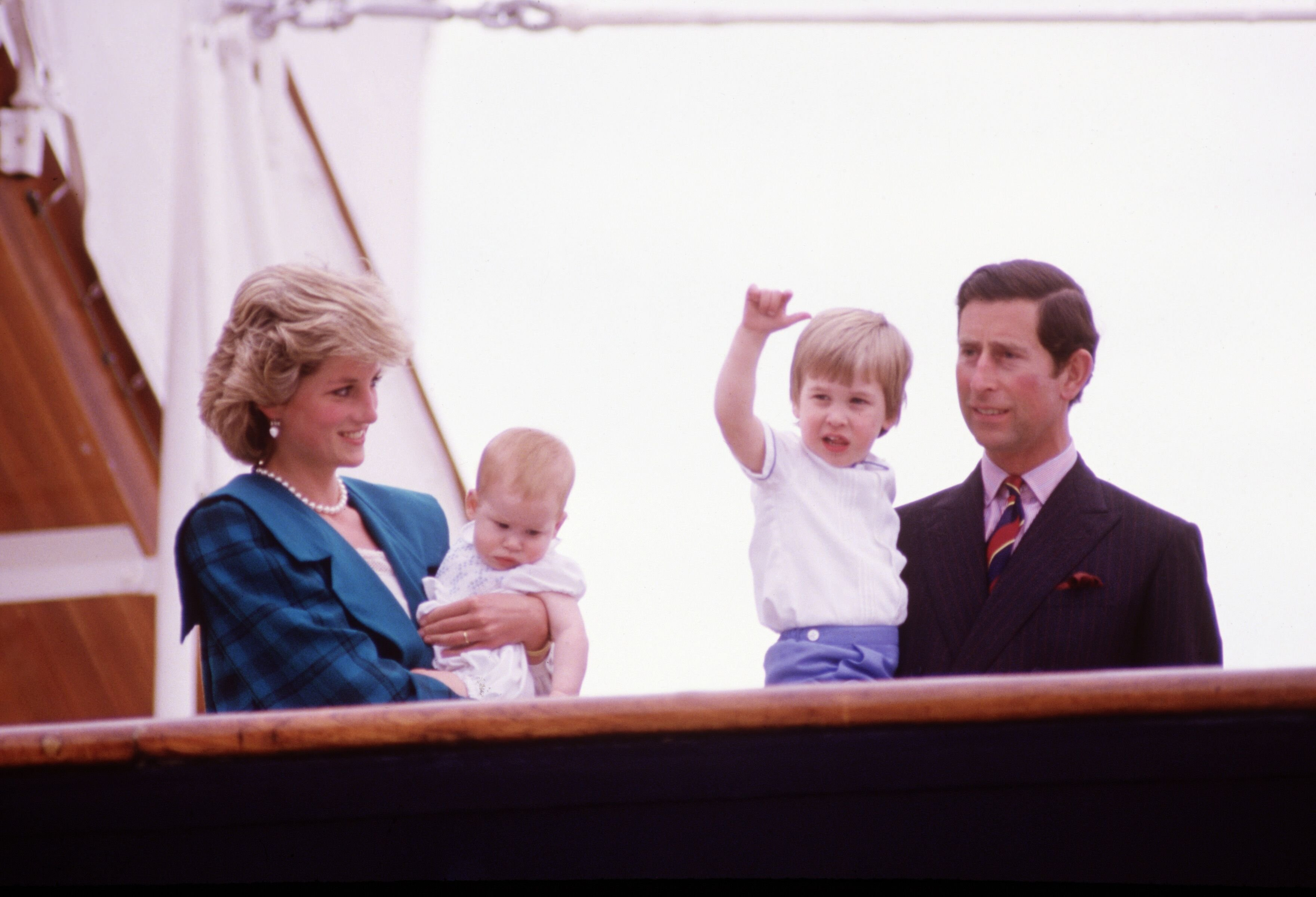 Diana Princess of Wales and Charles Prince of Wales hold Prince Harry and Prince William on the deck of the Royal Yacht Britannia, during the Royal Tour of Italy | Getty Images