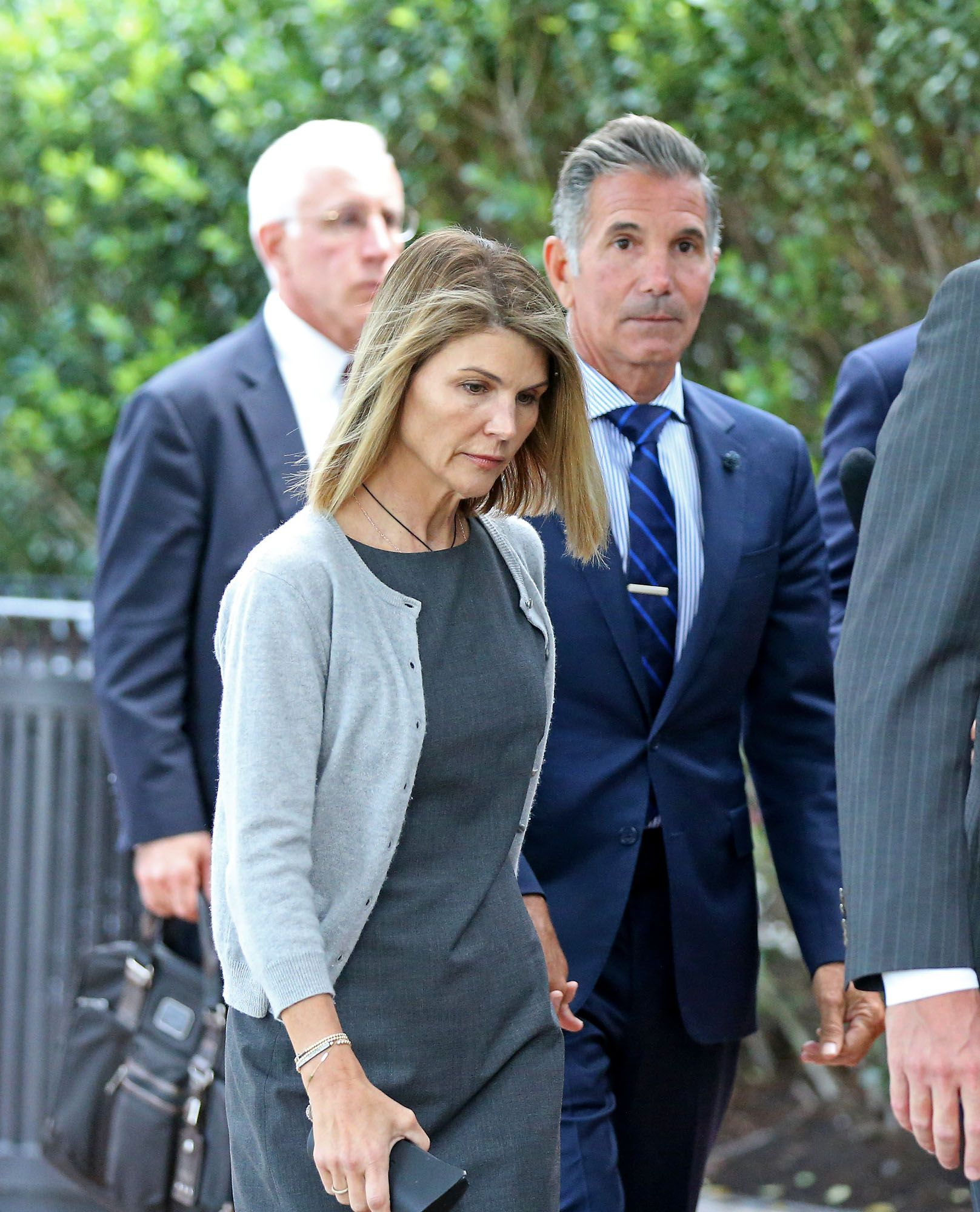Lori Loughlin and husband Mossimo Giannulli outside Moakley Federal Courthouse after a hearing in August 2019 in Boston, MA.   Source: Getty Images