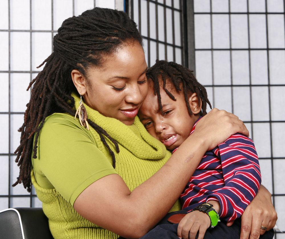 Little boy in tears in his mom's arms. | Photo: Getty Images