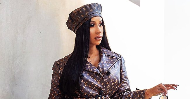 Cardi B Stuns in Louis Vuitton Coat and Matching Headband in a Stunning Photo