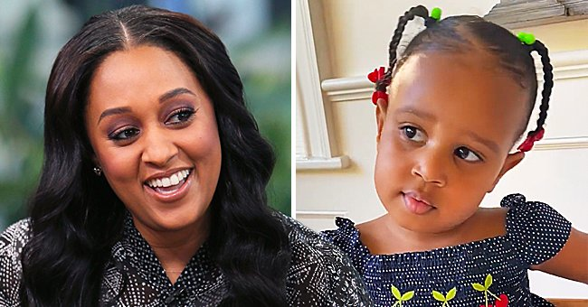 Tia Mowry's Daughter Melts Hearts Trying to Talk Wearing a Cherry-Print Polka-Dot Dress (Video)