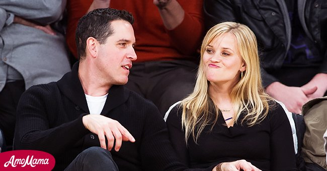Reese Witherspoon (R) and her husband Jim Toth attend a basketball game between the Toronto Raptors and Los Angeles Lakers at Staples Center on March 8, 2013 in Los Angeles, California. | Source: Getty Images