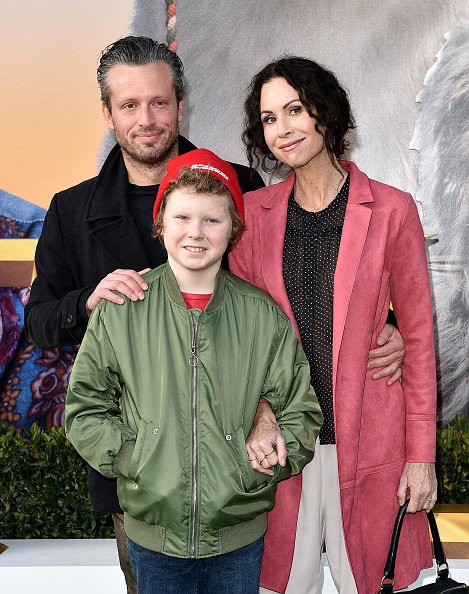 Minnie Driver, Addison O'Dea and Henry Story Driver at Regency Village Theatre on January 11, 2020 in Westwood, California. | Photo: Getty Images
