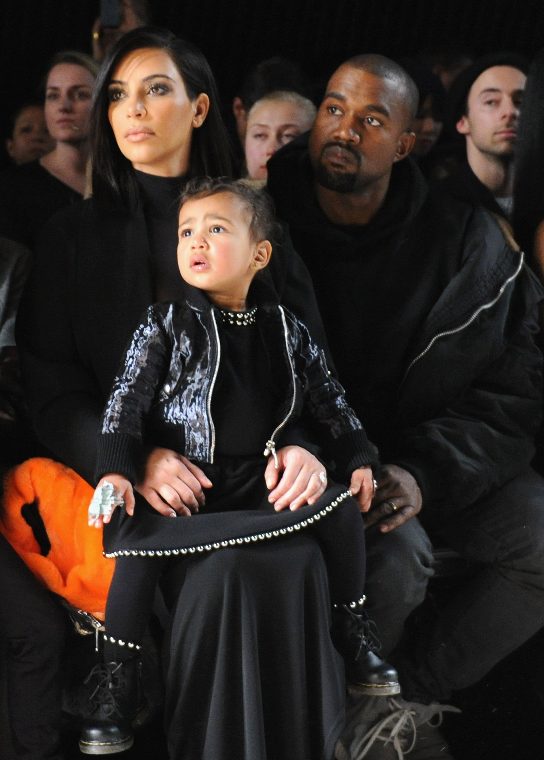 Kim Kardashian, North West and Kanye West attend the Alexander Wang Fashion Show during Mercedes-Benz Fashion Week Fall 2015 at Pier 94 on February 14, 2015, in New York City. | Source: Getty Images.
