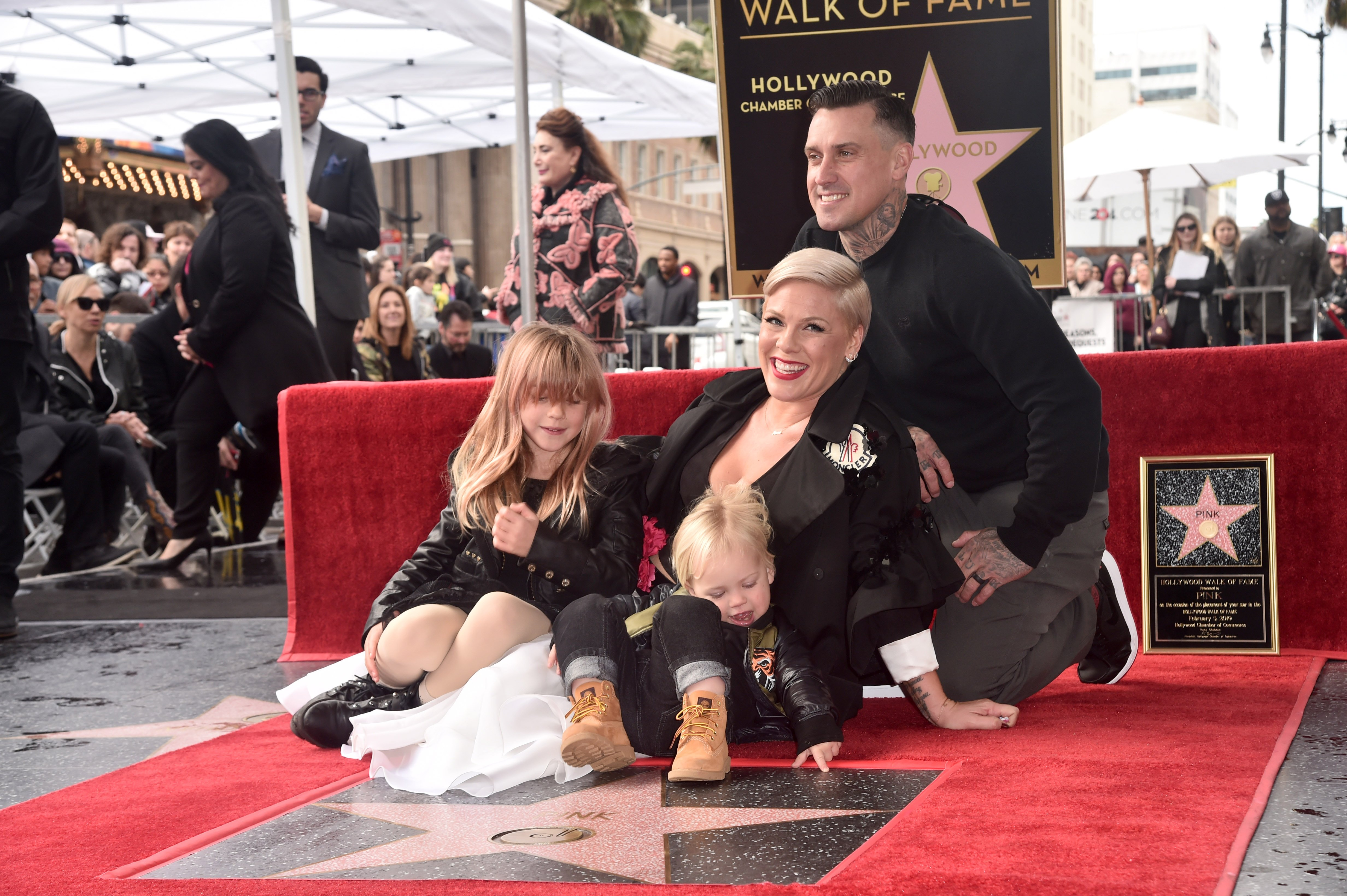 Pink receiving her Hollywood Walk of Fame Star accompanied by her children and husband | Photo: Getty Images