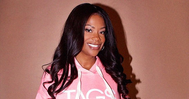 Fans Mistake RHOA Star Kandi Burruss for Daughter Riley as She Stuns in a Pink Sweater (Photo)
