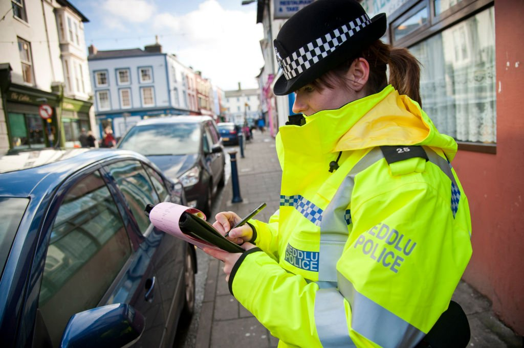 Dyfed-Powys police officer issuing a parking ticket   Photo: Getty Images