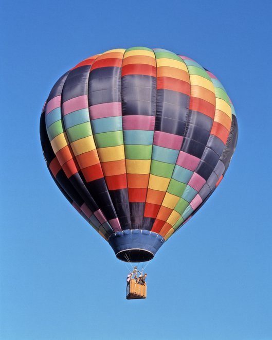 Photo of low angle view of people in hot air balloon    Photo: Getty Images