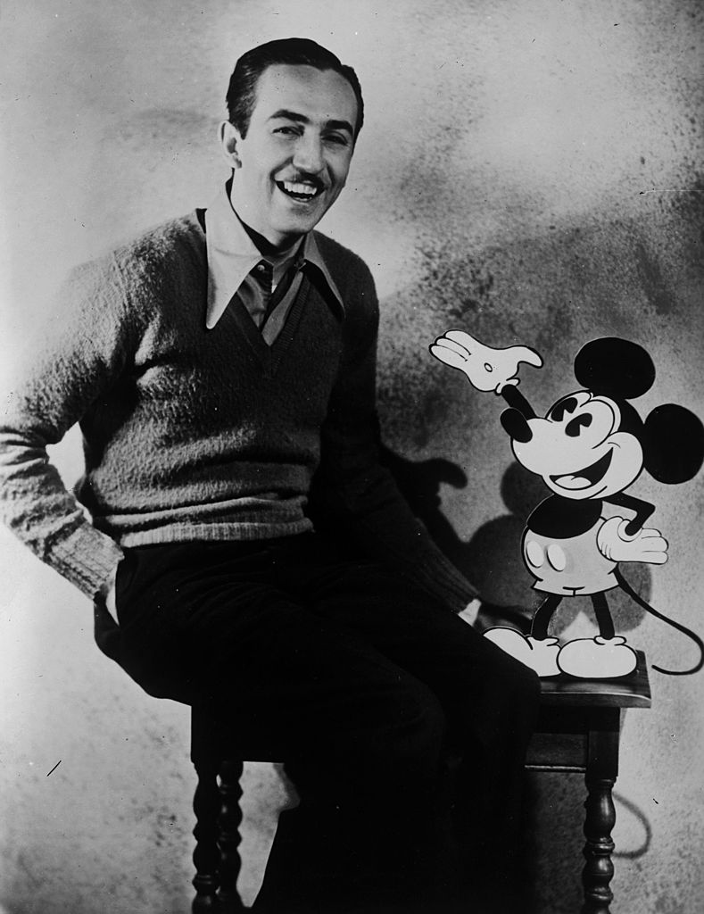American animator and producer Walt Disney with one of his creations Mickey Mouse | Getty Images