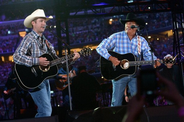George Strait and Bubba Strait at AT&T Stadium on June 7, 2014 in Arlington, Texas | Photo: Getty Images