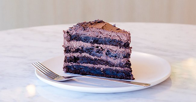A small piece of a larger portion of a freshly baked chocolate cake | Photo: unsplash.com/Will Echols