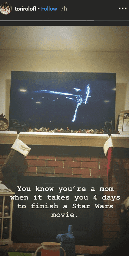 """Tori Roloff sitting on her couch shows a picture of her television screen showing a scene from """"Star Wars"""" 