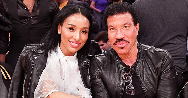 Lionel Richie's Much Younger Girlfriend Lisa Flaunts Her Legs Posing Barefoot in a Slit Dress