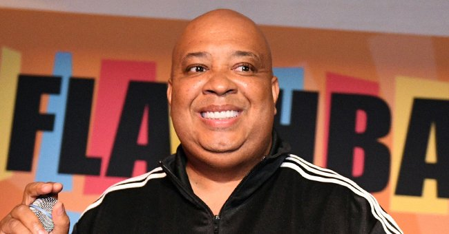 Rev Run Shows His 'Happy' Wife Justine Smiling in a Colorful Cape & Sunglasses in New Photo