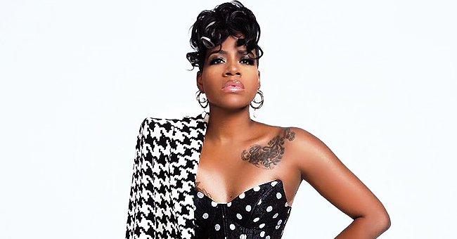 Fantasia Barrino Flaunts Some Skin & Tattoos in Black Minidress Paired with Long Coat & Boots