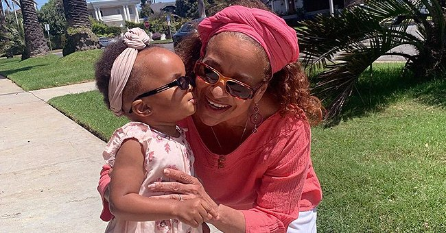 Debbie Allen Celebrates Grandparents Day with a Kiss from Her Granddaughter in a Floral Dress