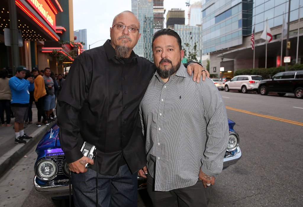 """Estevan Oriol and Mister Cartoon arrive at the premiere for """"Lowriders"""" at L.A. LIVE on May 9, 2017, in Los Angeles, California 